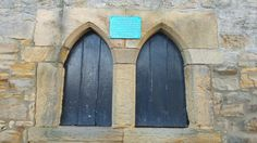 Hole in the wall, medieval style - in the boundary wall of St Andrew's Church, Corbridge, Northumberland, used to access the communal oven. Giving then each day their daily bread?