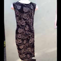 🎉HP🎉 Beautiful ruched LEIFSDOTTIR dress, NWOT This gorgeous black dress has khaki and gray flower pattern. It is made of 95% rayon and 5% spandex for the perfect fit.  The waist is defined by a cinch in the fabric that gathers to the right side. It is never been worn and is in perfect condition. Anthropologie Dresses