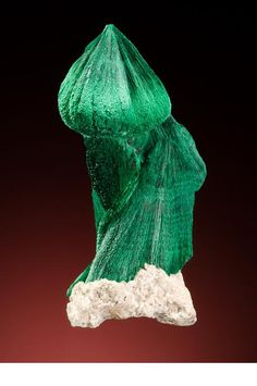 """Onion dome on a Russian church"" (4.3 cm high) –  ""Malachite ... from Kerouchen, Morocco.  Heliodor specimen  Wonderful aesthetics and an uncanny resemblance  to an  onion dome on a Russian church""  (Scovil, 2010, p.139)   (© photo by Jeff Scovil)."