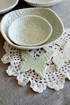 Use lace as a stamp for clay items.