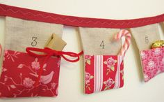 Bunting advent calendar 24 linen flags with beautiful Tilda 'Christmas House'  fabric pockets Eco friendly Over 7 1 /2 ft long MADE TO ORDER. £59.90, via Etsy.