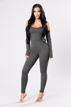 - Available in Charcoal - Skinny Leg Jumpsuit - Long Sleeve - Cold Shoulder - 94% Polyester 6% Spandex - Made in USA