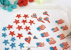 I piped the patriotic little cupcake toppers onto a parchment lined cookie sheet. Then, I chilled them in the freezer for just a few minutes as I worked on my cupcakes
