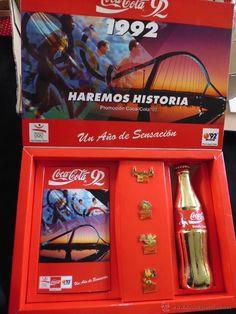 caja roja de coca cola con video pins y botella dorada año 1992 olimpiadas unica en TC