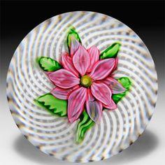 Antique Saint Louis pink clematis on latticinio swirl paperweight.  by  Saint Louis Antique