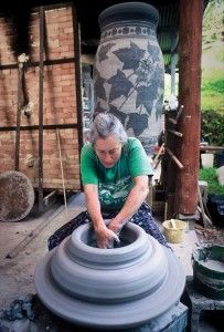 Sandy Vitarelli throwing a section of her huge vases...