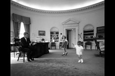   ... Caroline and John, Jr., dance in the Oval Office of the White House
