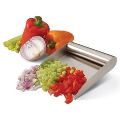 This nifty tool was destined for the chopping block. And that's a good thing. The PrepTaxi Food Scoop fills an important role in food preparation - getting your diced meats, chopped veggies and grated