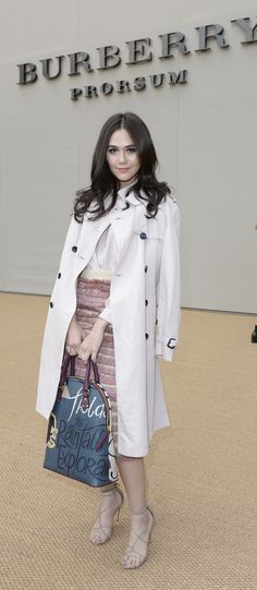 Thai actress Araya A. Hargate at the Burberry Prorsum S/S15 show wearing a Burberry Trench Coat and Bloomsbury Bag