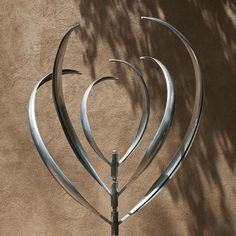 BLOOMING LILY 3 - STAINLESS STEEL - Mark White, wind sculpture
