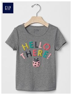 The gap collection of toddler girls tees has a variety of t-shirts and graphic tees for toddler girl. Find cute designs at Gap. Cute Toddler Girl Clothes, Toddler Girl Outfits, Kids Outfits, Girls Blouse, Disney Shirts For Family, Kid Styles, Baby Gap, Baby Wearing, Kids Wear