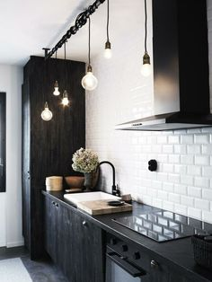 white tile :: backsplash; love the black cabinets