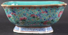 A 19TH CENTURY CHINESE PORCELAIN ENAMELLED SQUARE FORM BOWL Tongzhi, painted with foliage. 6ins wide.