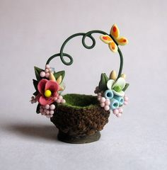 This miniature pretty petite flower & butterfly embellished basket is a one of a kind original design and creation by artist C. Barbie Dolls Diy, Diy Doll, Clay Fairy House, Clay Fairies, Mini Fairy Garden, Cute Clay, Clay Animals, Tiny Treasures, Polymer Clay Creations