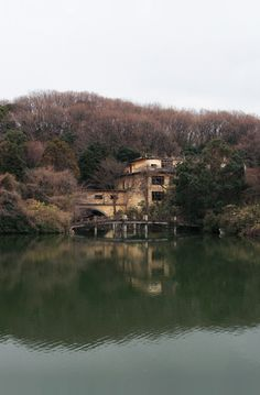 One Dragon Inn, Osaka, Japan. A hotel built partly over a lake. Closed for at least 25 years. Abandoned hotel.