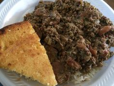 Smothered Okra with sausage and shrimp, over rice with a slice of cornbread