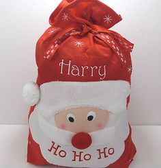 Personalised Ho Ho Ho Santa Sack   with fun applique Santa image,   pompom and drawstring top.   Approximate size 73cm high by 56cm wide   (28.5 inches high by 19 inches wide)   Any 1 name of your choice embroidered