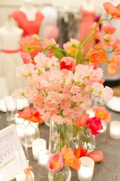 Watermelon poppies and peachy sweet peas combine into beautiful centerpieces. #peach #wedding #centerpiece
