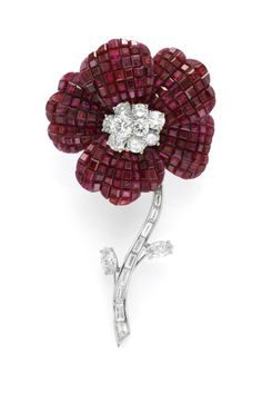 Van Cleef & Arpels. A Mystery-Set Ruby and Diamond Flower Brooch – Tony Falcone © Van Cleef & Arpels