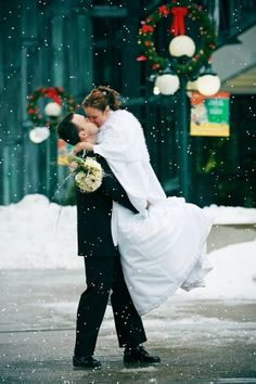 such a pretty wedding picture with the christmas and winter background