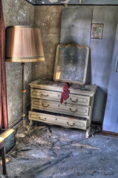 Old lamp and dresser at the abandoned docters house (dr.pepito) located near Diest in Belgium