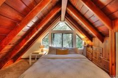 Cozy Upstairs Sleeping Loft with Awesome Windows and Built-in Storage