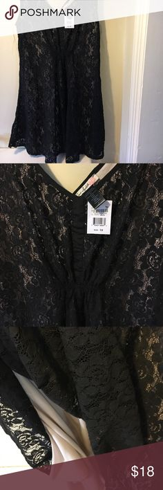 Gorgeous black lace nude lining 1X dress This is a gorgeous dress purchased at Macy's never got to be worn. It is a beautiful black lace with a nude lining. It is a size 1X. And retailed for $98. Love Squared Dresses Midi