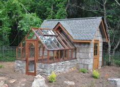 This Tudor Style Gable end attached greenhouse is one of my favorites. The texture of rustic rock and shingles plays off the sleek redwood in a serviceable yet stunning shed/greenhouse combo. Posted by: Sturdi-built Greenhouse Mfg Greenhouse Shed Combo, Diy Greenhouse Plans, Backyard Greenhouse, Small Greenhouse, Backyard Landscaping, Greenhouse Attached To House, Greenhouse Wedding, Garden Buildings, Garden Structures