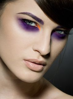 Purple/orange eyes, nude lips.