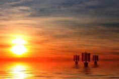 viking ships at sunset by Peter Kirschner