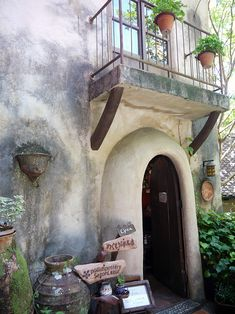 simple doorway with overhanging balcony at ghibli village in japan