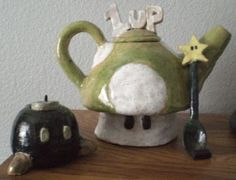 I want this tea set so bad! To bad it is something someone made in high school and not something I can buy.... I might have to ask a high school-er to make one for me! lol