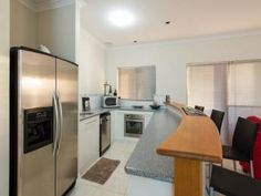 Side-by-side fridge in a kitchen design from an Australian home - Kitchen Photo 6914001
