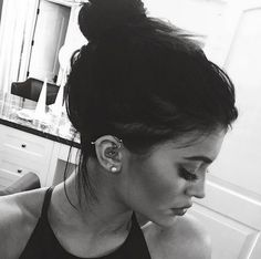 Adorable messy bun and piercings!