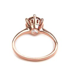 Anna Sheffield's Hazeline solitaire engagement ring 14k rose gold is an unique engagement ring, classic with a twist