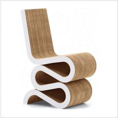 Frank Gehry Wiggle Chair.  The granddaddy of paper and card chairs, originally made in the 60's now reproduced by Vitra.