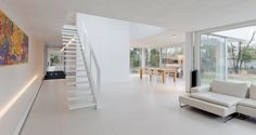 Long lines and a light filled doubleheight space inside this interior by Filip Deslee.