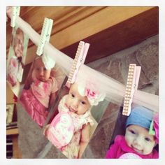 Tulle + Bejeweled Clothespins = an adorable way to display monthly photos at #firstbirthday!