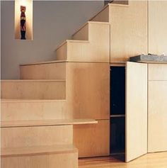 built in cabinets under stairs