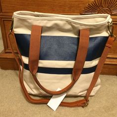 """Blue and white bag Tote bag with small strap and removeable longer strap. Shi (brand). Never used tags still attached. Cream/white with blue stripe. Brown color in straps. Canvas. 12x13"""" Shi Bags"""