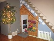 Ever wonder what to do with the space under your stairs?  Try making a playhouse for your kids or grandkids.   Our grandkids love it!