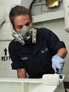 PACIFIC OCEAN (May 9, 2013) - Seaman Melissa Roman, from Chicago, Ill., paints a cooling coil unit aboard the aircraft carrier USS Nimitz (CVN 68). Nimitz is currently underway on a scheduled Western Pacific deployment. (U.S. Navy photo by Mass Communication Specialist 3rd Class Raul Moreno Jr.)
