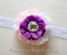 ~ RapunzelLove Baby Headband ~  A white and purple felt flower and pink with white polka dot tulle are attached to a white elastic lace headband with a khaki green heart-shaped crystal embellishment.  A Disney Rapunzel Princess inspired headband just for your lovely princess or as a gi...
