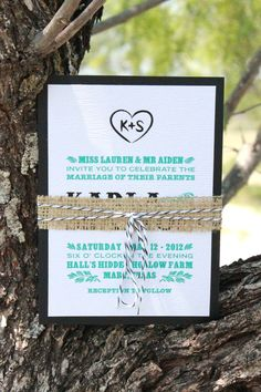 wood grain embossed, turquoise and black, modern rustic wedding invitation with burlap band and baker's twine