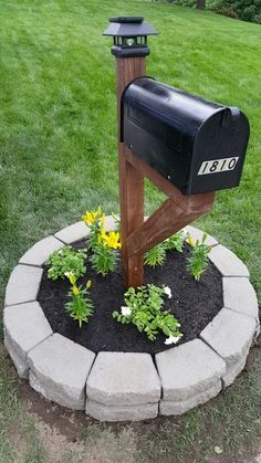 4x4 stained post, mailbox, solar light post topper, retaining wall blocks, flowers. There you have it; A complete mailbox makeover! #landscapemailbox