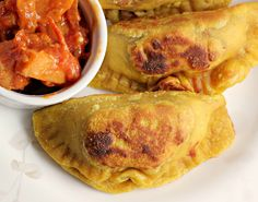 Curry Spiced Sweet Potato Samosas with a Persimmon Tomato Marmalade.  This is a really good food blog.