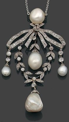 A natural pearl, diamond, platinum and gold pendant, circa 1900. The ribbon bow and laurel wreath pendant set with brilliant-cut diamonds suspending four pear-shaped pearl drops, mounted in platinum and 18K gold. #BelleEpoque #pendant