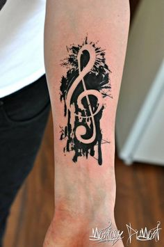 work by monique dumont at Amazon Tattoo + Piercing negative space design music note