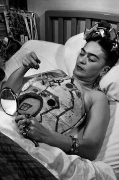 """Paris Review – Frida's Corsets, Leslie Jamison  """"Frida Kahlo wore plaster corsets for most of her life because her spine was too weak to support itself. She painted them, naturally, covering them with pasted scraps of fabric and drawings of tigers, monkeys, plumed birds, a blood-red hammer and sickle, and streetcars like the one whose handrail rammed through her body when she was eighteen years old."""""""