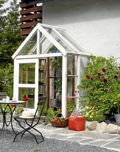small greenhouse. We hillbillies refer to this as a lean-to--b/c it's leaning up against the house. Whatever you call, it's pretty!